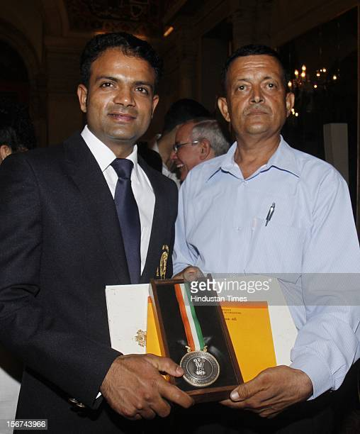 Indian Wrestler Yogeshwar Datt with his father after recieving Rajiv Gandhi Khel Ratna Award from Indian President Pranab Mukherjee during the Sports...