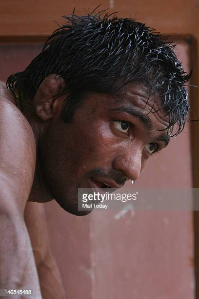 Indian wrestler Yogeshwar Dutt practising at the Olympic training camp organised at Sports Authority of India complex in Sonepat