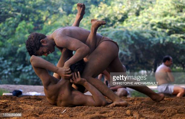 Indian wrestlers fight during a practice session, at an Akhara ground on the outskirts of New Delhi, 22 September 2007. India's indigenous form of...