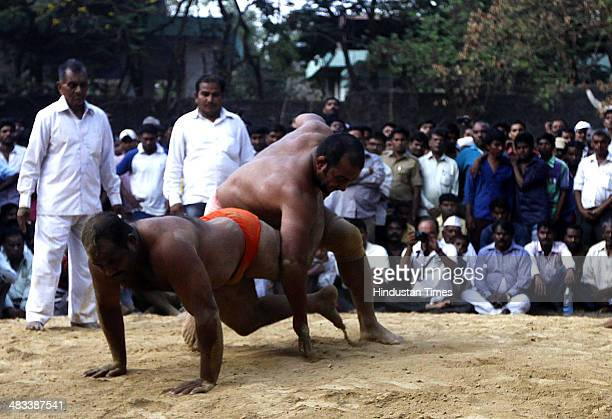 Indian wrestlers trying their strength in mud wrestling tournament organized on the occasion of Ram Navmi at Belapur village on April 8 2014 in...