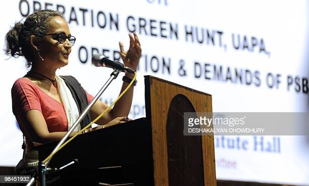 Indian writer and activist Arundhati Roy gestures as she addresses a gathering of intellectuals and students in Kolkata on April 14 2010 Hundreds of...