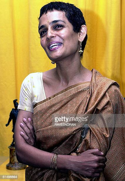 Indian writer and Booker Prize Winner Arundati Roy addresses in New Delhi 26 April 2001 after received the French award of 'Knight of the Order of...