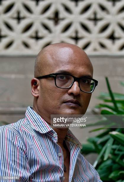 Indian writer Jeet Thayil poses at his home in New Delhi on September 20, 2012. Thayil was shortlisted for Britain's prestigious Booker Prize for his...