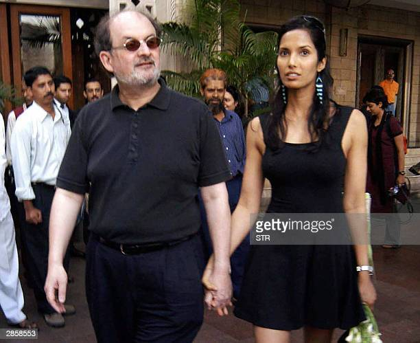 Indian writer Salman Rushdie along with model and actress girl friend Padma Lakshmi walk out of a hotel in Bombay10 January 2004 Rushdiewho has...