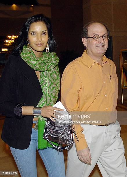 Indian writer Salman Rushdie and his wife Padma Laxmi walk off from a city hotel in Calcutta 08 December 2004 Rushdie is on a twoday personal visit...