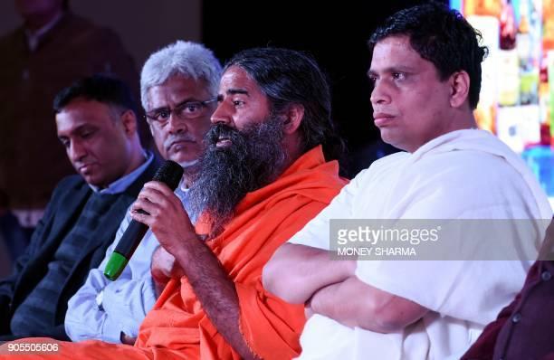 Indian yoga guru Baba Ramdev and Patanjali Ayurveda Managing Director Acharya Balkrishna during a press conference in New Delhi on January 16 2018...