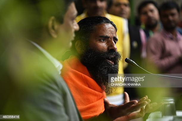 Indian yoga guru Baba Ramdev gestures as he speaks to the media during a press conference on the declaration of a 'yoga day' in New Delhi on December...