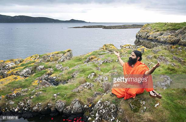 Indian Yoga Guru Baba Swami Ramdev Practices On The Island Of Little Cumbrae Off