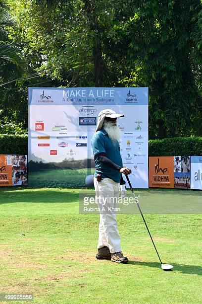 Indian yogi and mystic Sadhguru Jaggi Vasudev tees off at the Make A Life Golf Jaunt to raise funds for Isha Vidhya the rural education arm of his...