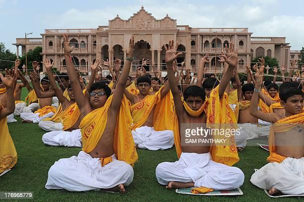 Indian young Brahmins from the Shree Swaminarayan Gurukul Vishwavidya Pratishthanam participate in the Janoi or 'sacred thread' changingceremony on...