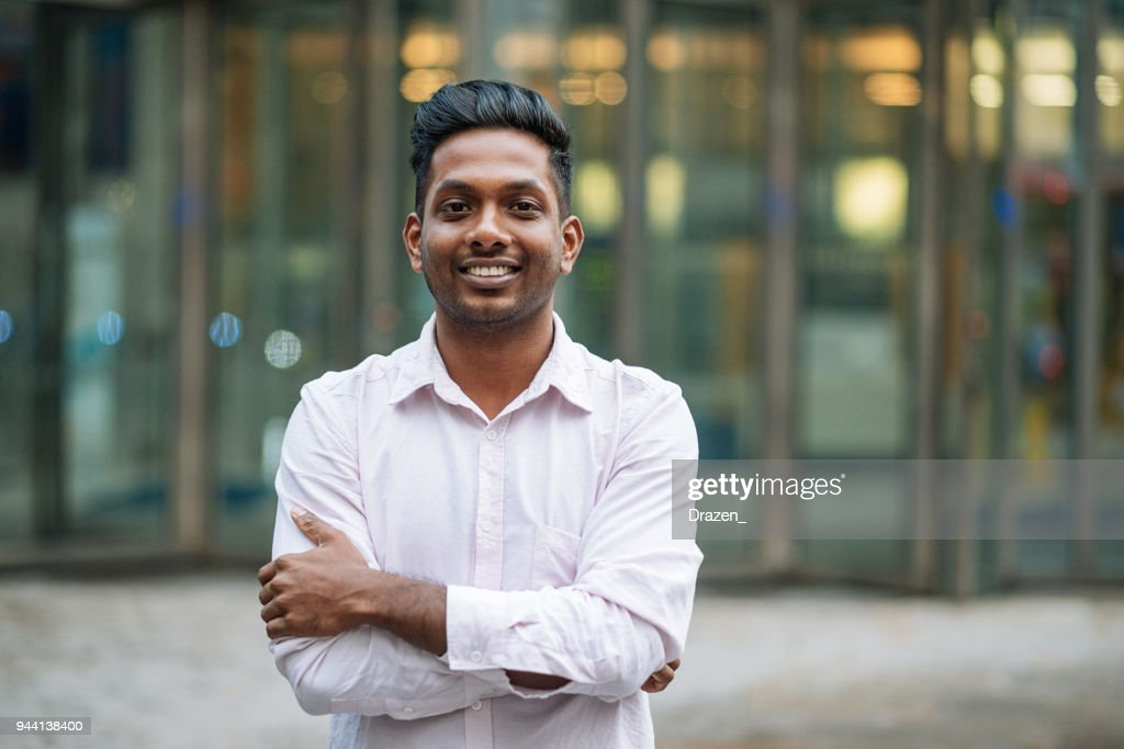 Indian young man in London, expressing positive emotion : Stock Photo