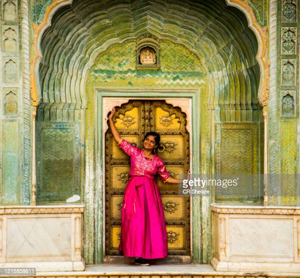 indian young woman at city palace jaipur in rajasthan state, india - amber fort stock pictures, royalty-free photos & images