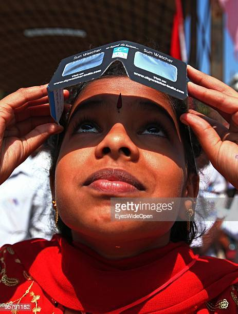 Indian young woman observes the rare Annular Solar Eclipse at the central stadium on January 15 2010 in Thiruvananthapuram Kerala South IndiaThis...