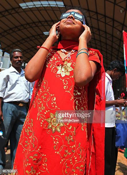 Indian young woman observes the rare Annular Solar Eclipse on January 15 2010 at the central stadium of Thiruvananthapuram in Kerala South IndiaThis...
