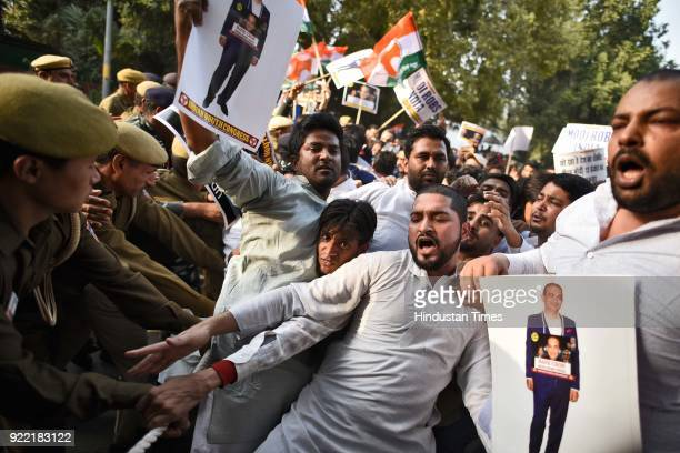 Indian Youth Congress activists and workers scuffle with police during a protest march against Finance Minister Arun Jaitley and Punjab National Bank...
