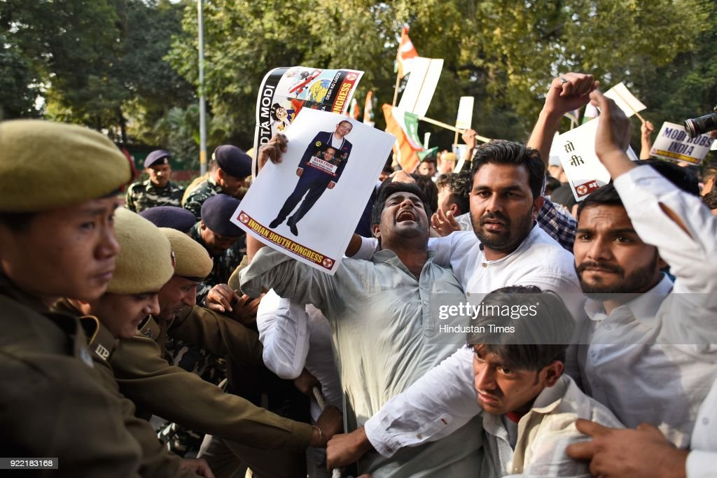 Indian Youth Congress activists and workers scuffle with police during a protest march against Finance Minister Arun Jaitley and Punjab National Bank.