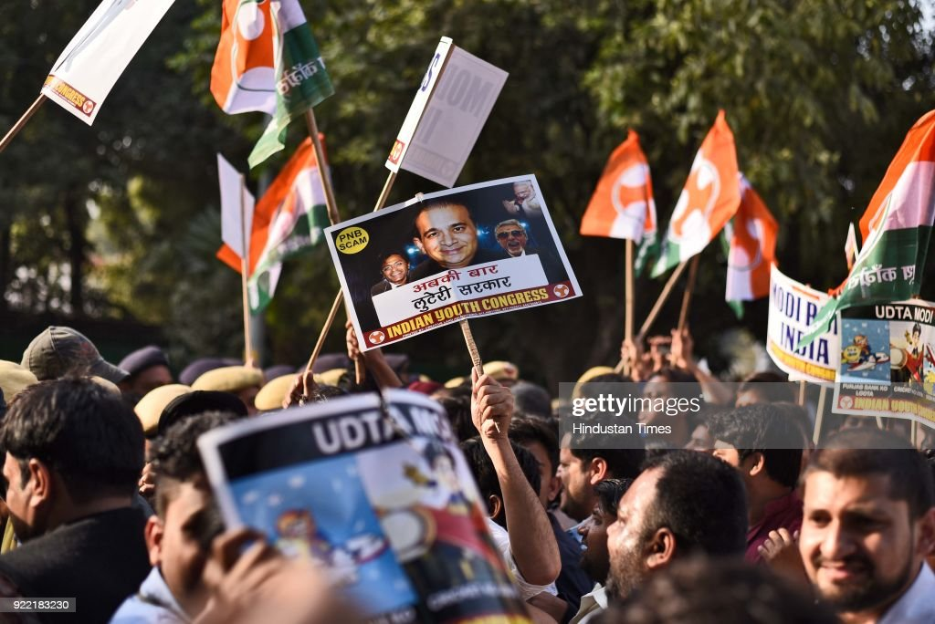 Indian Youth Congress activists and workers scuffle with police during a protest march against Finance Minister Arun Jaitley and Punjab National Bank (PNB) scam at IYC office, on February 21, 2018 in New Delhi, India.