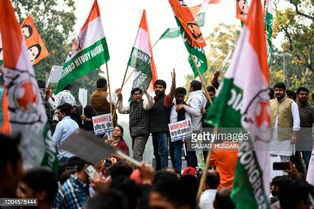 Indian Youth Congress activists shout slogans during a protest demanding the resignation of Home Minister Amit Shah and the registration of a First...