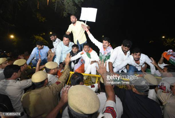 Indian Youth Congress and NSUI activists protest against the removal of Special Protection Group protection for Congress President Sonia Gandhi and...