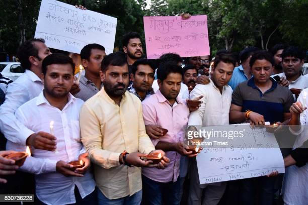 Indian Youth Congress members and activists hold a candlelight vigil in memories of the 30 children died in Gorakhpur hospital outside Uttar Pradesh...