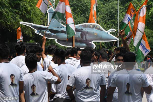 Indian Youth Congress supporters and activists raise slogans against NDA government over the alleged Rafale fighter aircraft deal scam during a...