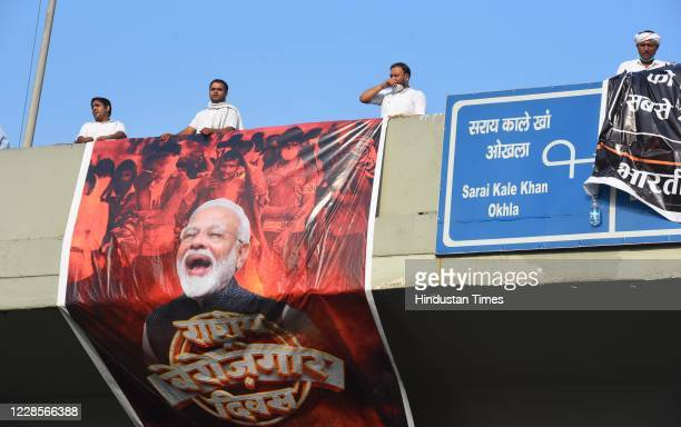 Indian Youth Congress supporters hold banners and shout slogans during a protest demanding jobs on the occasion of Prime Minister Narendra Modis 70th...