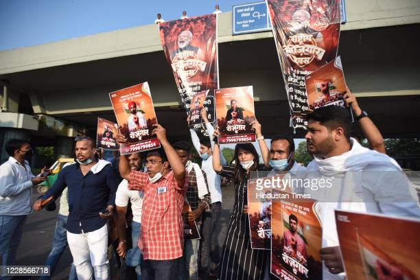 Indian Youth Congress supporters hold placards and shout slogans during a protest demanding jobs on the occasion of Prime Minister Narendra Modis...