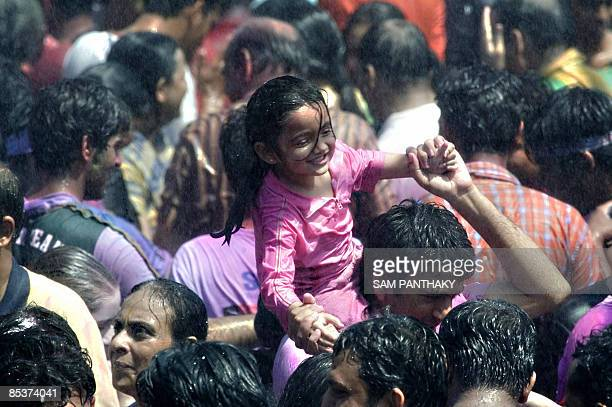 Indian youth dance during Rain Dance celebrations to celebrate Holi the 'festival of colours' in Ahmedabad on March 11 2009 The Holi festival is...