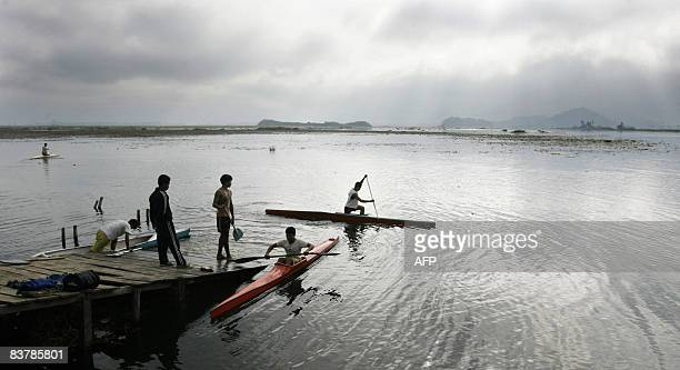 Indian youth paddle their kayaks on Loktak lake some 48 kms southwest of Imphal in Manipur state on November 22 2008 Loktak lake is the largest...