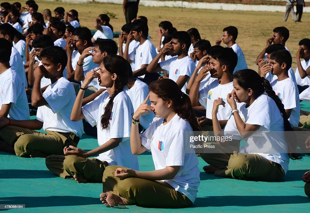 Indian youth performing yoga to mark first International... : News Photo