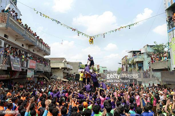 Indian youths from the Chhara Community the denotified tribes of Chharanagar form a human pyramid in an effort to reach and break a 'dahihandi'...