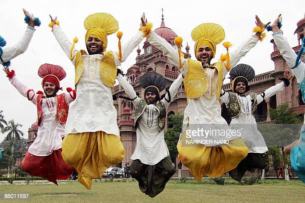 Indian youths perform the Bhangra a traditional Punjabi folk dance during the annual Sports Day function at Khalsa College in Amritsar on February 24...