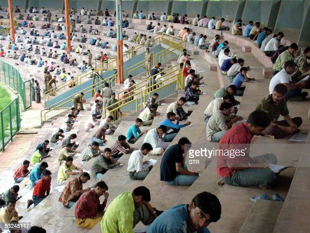 Indian youths take a written entrance exam hoping to become eligiable for one of the 1500 vacant posts in the Madhya Pradesh State Police Department...