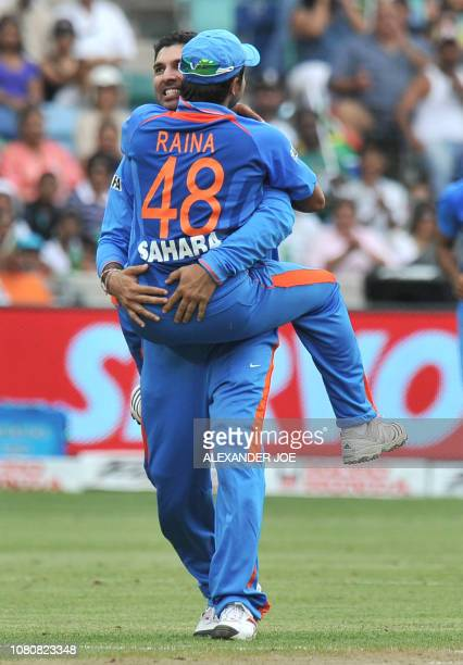 Indian Yuvraj Singh and teammate Indian Suresh Raina celebrate dismissing South African Abraham Benjamin de Villiers during a Twenty20 xcricket match...