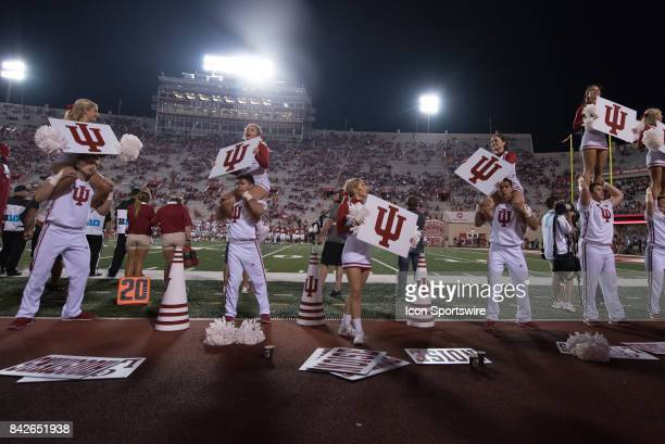 Indiana cheerleaders cheer on the student section near the end of their season opening college football game between the Ohio State Buckeyes and the...