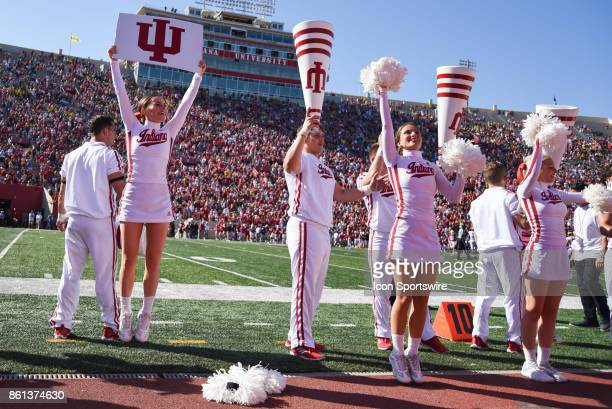 Indiana cheerleaders pump up the crowd late in a college football game between the Michigan Wolverines and the Indiana Hoosiers on October 14 2017 at...