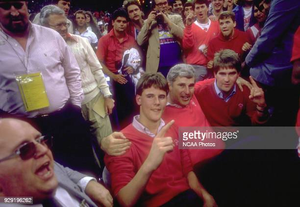 Indiana coach Bob Knight and his two sons Pat and Tim celebrate after defeating Syracuse 7473 for the NCAA Photos via Getty Images Men's National...