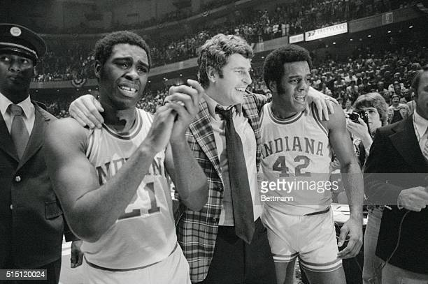 Indiana coach Bobby Knight center is walked off the court in jubilation by a tearful Quinn Buckner left and Scott May after the Hoosiers won the NCAA...