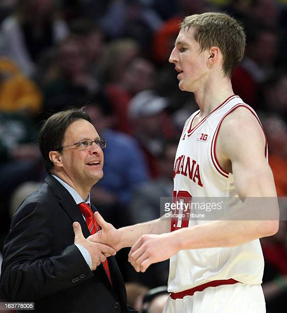 Indiana coach Tom Crean shakes Cody Zeller's hand in the first half of action against Illinois during the quarterfinals of the 2013 Big Ten...