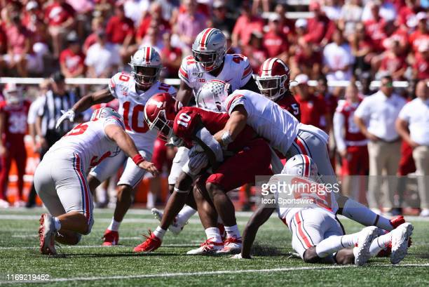 Indiana David Ellis tackled by Ohio State defenders during a college football game between the Ohio State Buckeyes and Indiana Hoosiers on September...