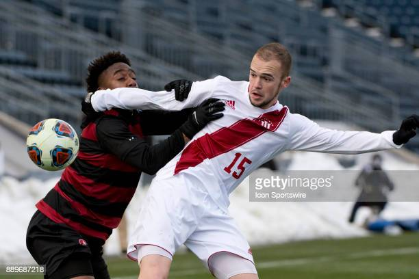 Indiana Defender Andrew Gutman holds back Stanford Midfielder Bryce Marion from the ball in the second half during the College Cup game between The...