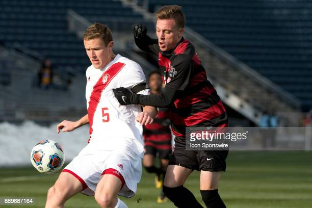 Indiana Defender Grant Lillard keeps the ball from Stanford Forward Corey Baird in the second half during the College Cup game between The Stanford...