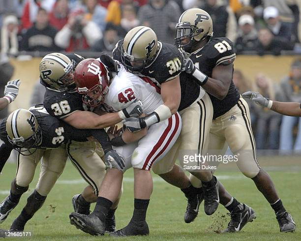Indiana FB Josiah Sears is surrounded by Purdue defenders Dan Bick 36, George Hall 30 and teammates. Purdue defeated Indiana 28-19 in Ross Ade...