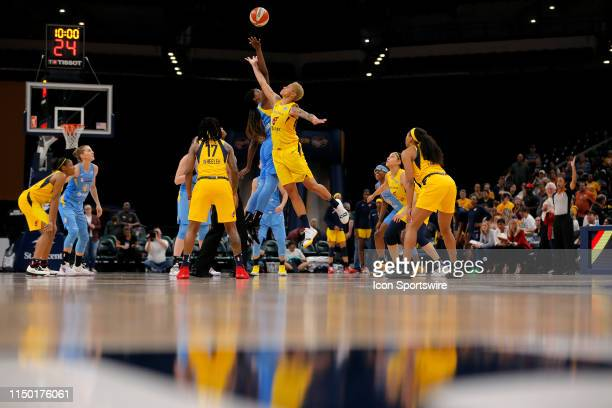 Indiana Fever forward Candice Dupree goes up with Chicago Sky forward Jantel Lavender for the opening tip off during the game between the Chicago Sky...