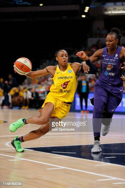 Indiana Fever guard Tiffany Mitchell makes a strong move into the lane during the game between the Phoenix Mercury and Indiana Fever June 09 at...
