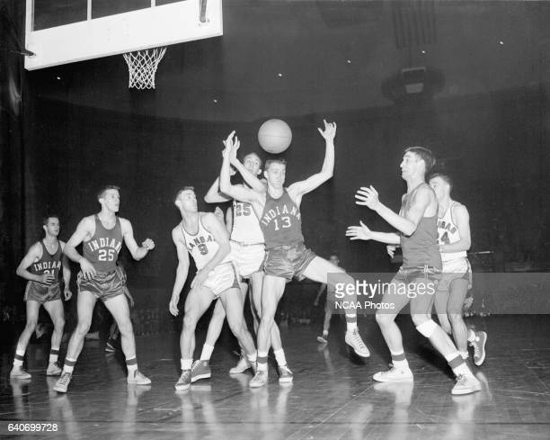 Indiana forward Charles Kraak scrambles for the rebound during the controversial 1953 National championship game Indiana vs Kansas held at the...