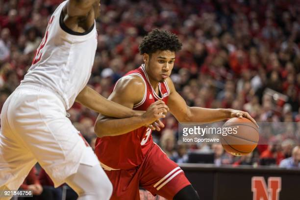 Indiana forward Justin Smith dribbles the ball against Nebraska center Jordy Tshimanga during the second half of a college basketball game Tuesday...