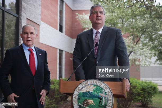 Indiana Gov. Eric Holcomb and U.S. EPA Administrator Scott Pruitt address the media after meeting with former residents and taking a brief tour of...