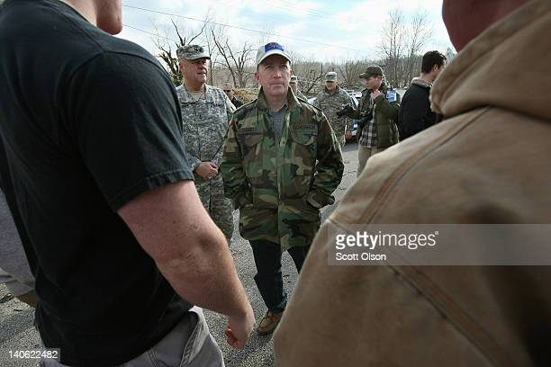 Indiana Gov. Mitch Daniels talks to students outside the Henryville School during a vist to the tornado-ravaged town March 3, 2012 in Henryville,...