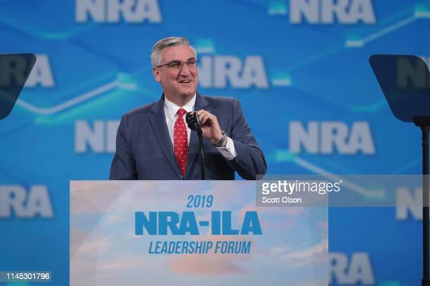 Indiana governor Eric Holcomb speaks to guests during the NRA-ILA Leadership Forum at the 148th NRA Annual Meetings & Exhibits on April 26, 2019 in...